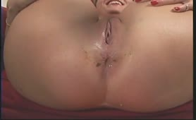 Horny MILF pooping on a red plate