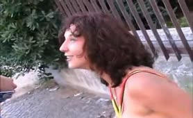 Mature slut drinking piss in public