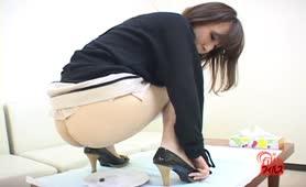 Examine her own poop