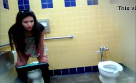 Brunette latina shitting in boys bathroom