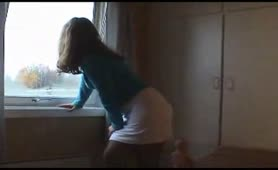Hot brown haired teen peeing in white skirt