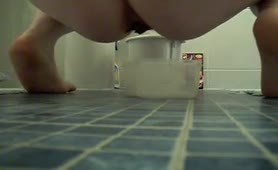 Fat amateur teen shitting on bathroom floor