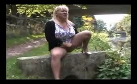 Hot mature blonde peeing in public