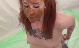 Tattooed redhead masturbating with poop