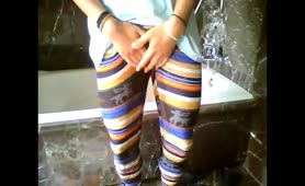 Kinky girlfriends enjoys peeing in her tights