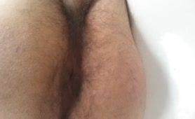 Hairy Italian boy pooping in close up