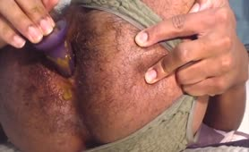 Hairy guy masturbating with a purple dildo