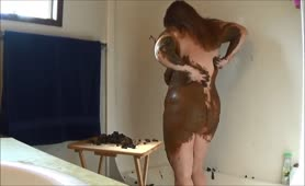 Fat girl rubbing shit on her entire body