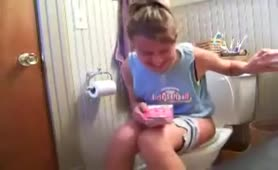 Sexy teen shitting in toilet