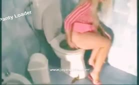 Blonde girl missed the toilet