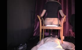 Sexy babe shitting on male slave