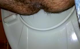Hairy guy shitting