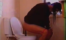 Brunette girl pooping