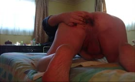 Fingering his tight asshole