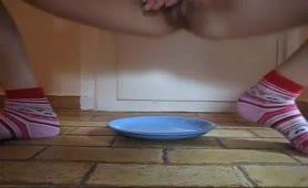 Shitting on a blue plate