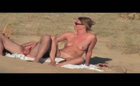 German MILF peeing at a nudist beach