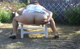 Horny housewife pooping in garden