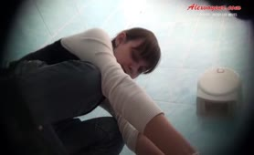 Hot college girl peeing in a public bathroom