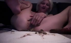 Blonde babe stuffed her pussy with poop
