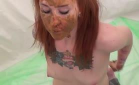 Tattooed redhead masturbating with poop