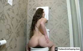 Brown haired teen shitting in toilet