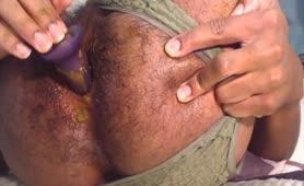 Hairy guy masturbating with a purple dildo