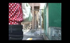 Asian school girl pooping in a public place