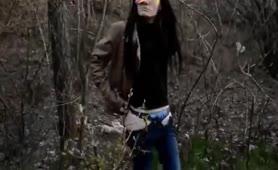 Dark haired babe shitting in forest