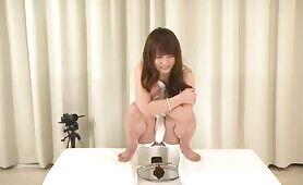 Dark haired japanese girl pooping