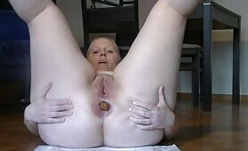 Shaved babe shitting a lot